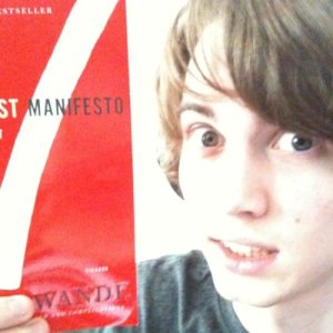 I look rather manic in this photo. Maybe I'm just excited to have a copy of The Checklist Manifesto? :-p