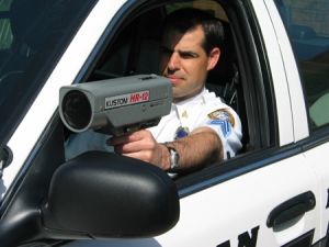 Policeman with radar gun.